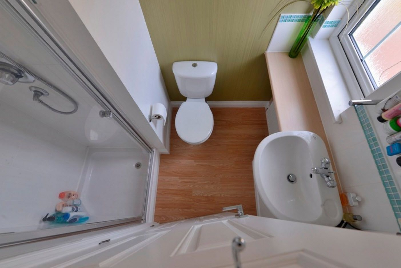 Top close-up view at the combined bathroom and toilet