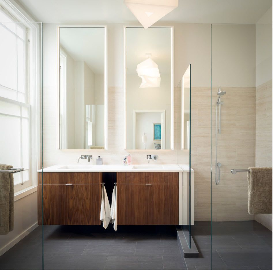 Noble suspended vanity with wooden facade in the creamy design of the modern bathroom