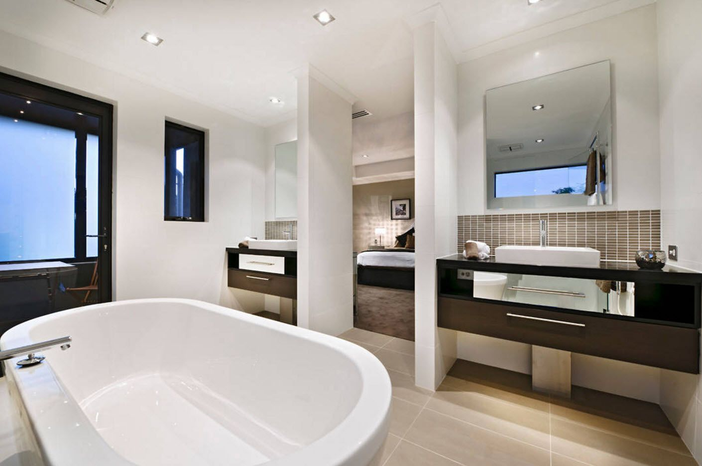 Large bathroom with complex of storage systems zoned by panels and oval bathtub