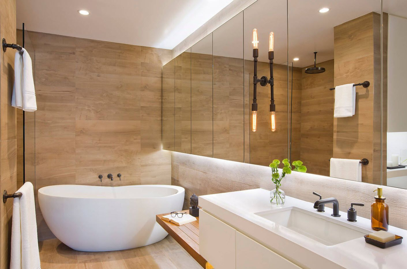 Glass surfaces and wooden accent wall with suspended lighting - cutting edge design idea for your bathroom