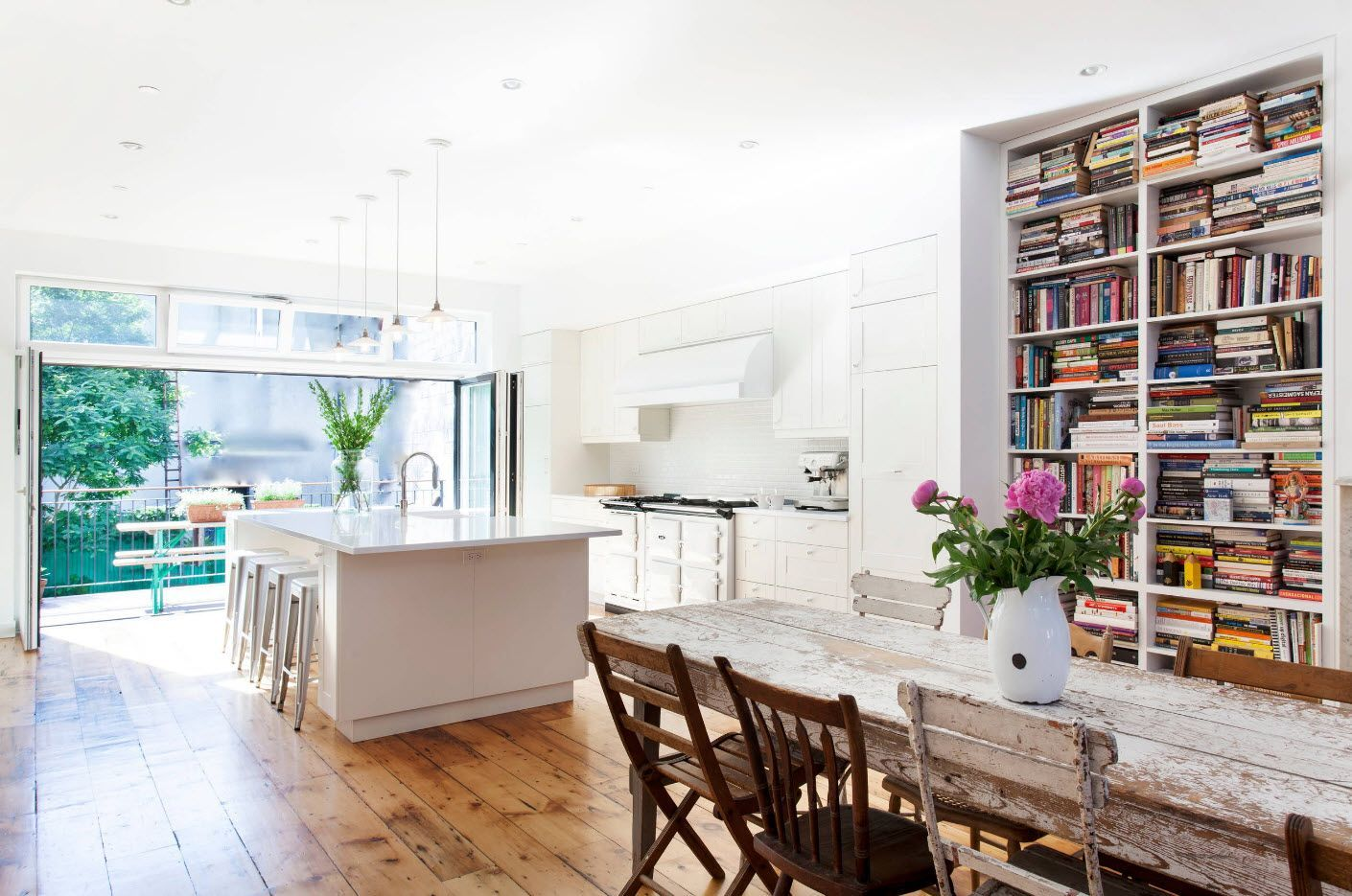 Couple of zones in the homey modern complex designed kitchen with parquet flooring