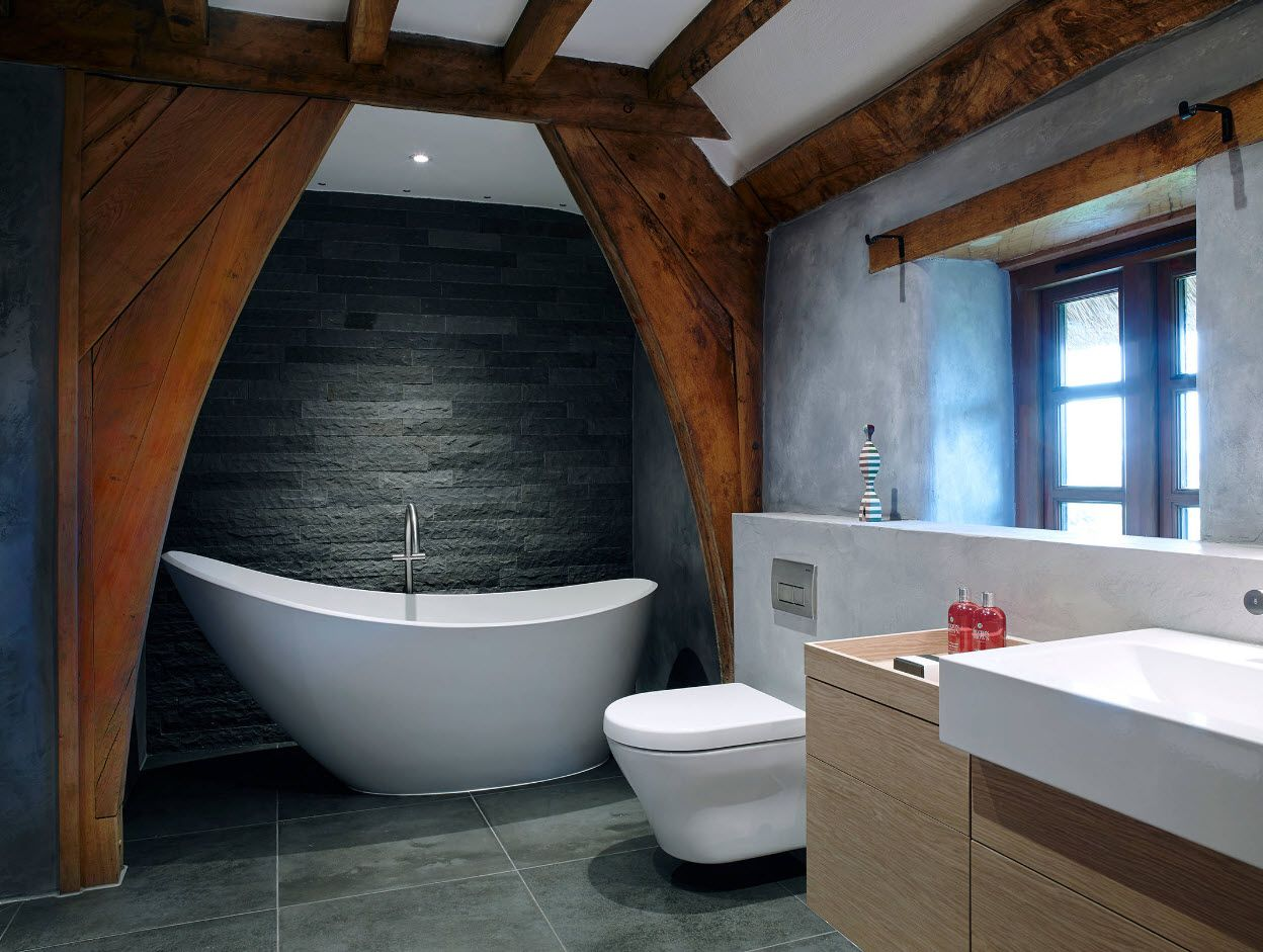 Charcoal accent wall and wooden vault in the bathroom