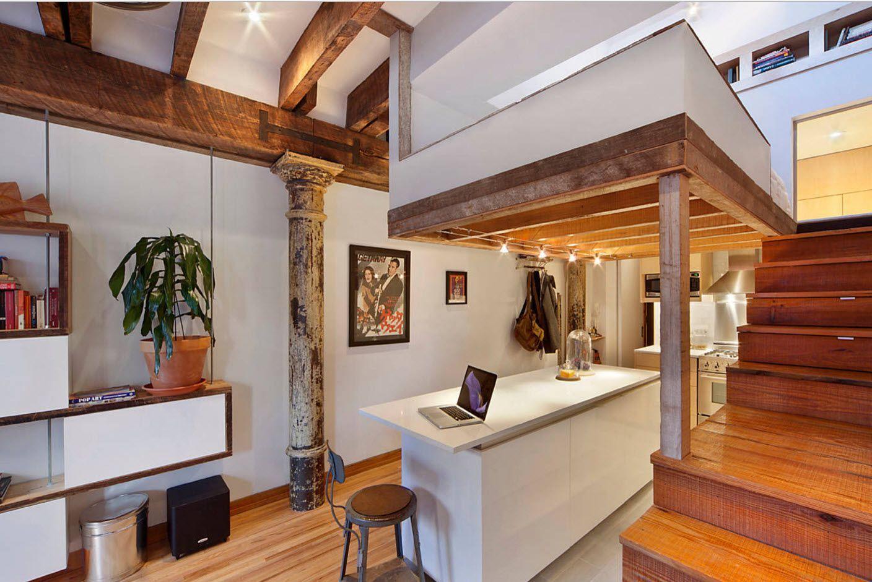 Kitchen in the two-storey Greek design apartment decorated in unbeaten speckless fashion