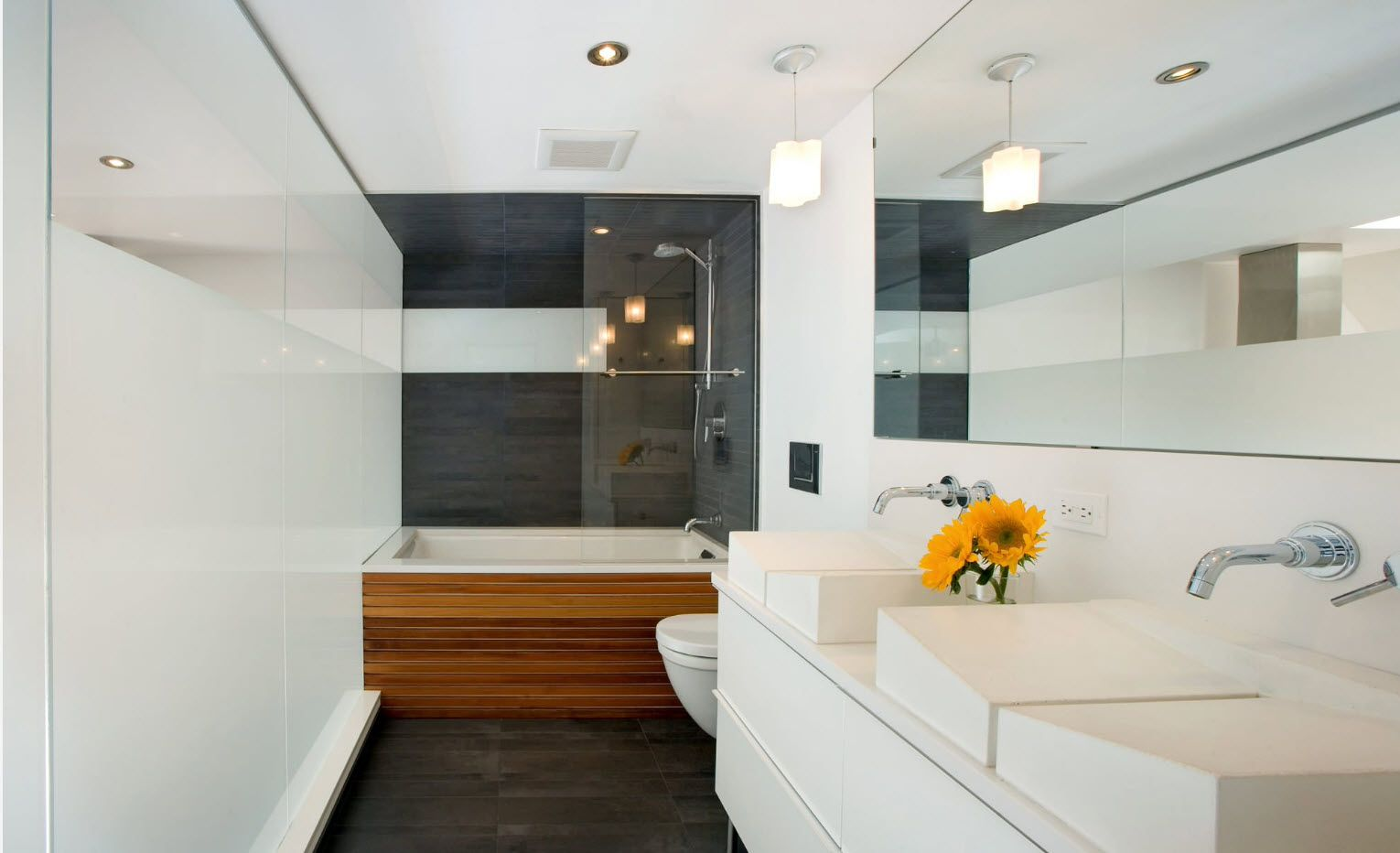 Gray color of the walls and wooden surface of the bathtub