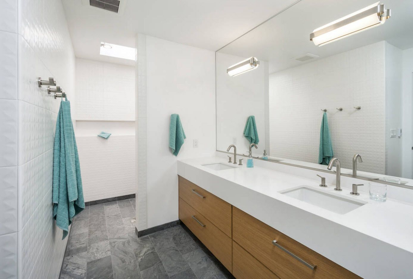Absolutely white sterile atmosphere of the bathroom diluted by towels