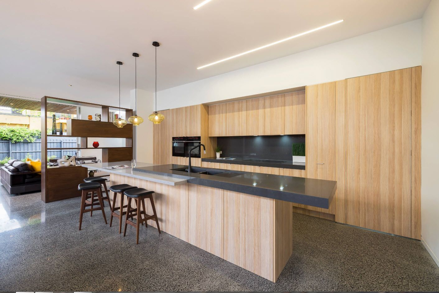 Light wooden decoration of the kitchen with white ceiling