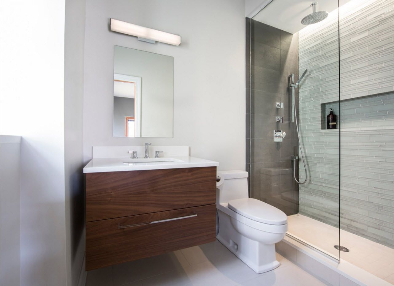 suspended dark wooden vanity and light bathroom decoration