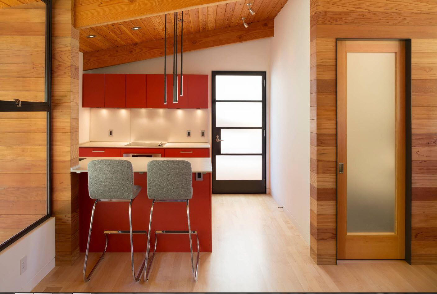 Slanting wooden ceiling and the red sttold at the forefront