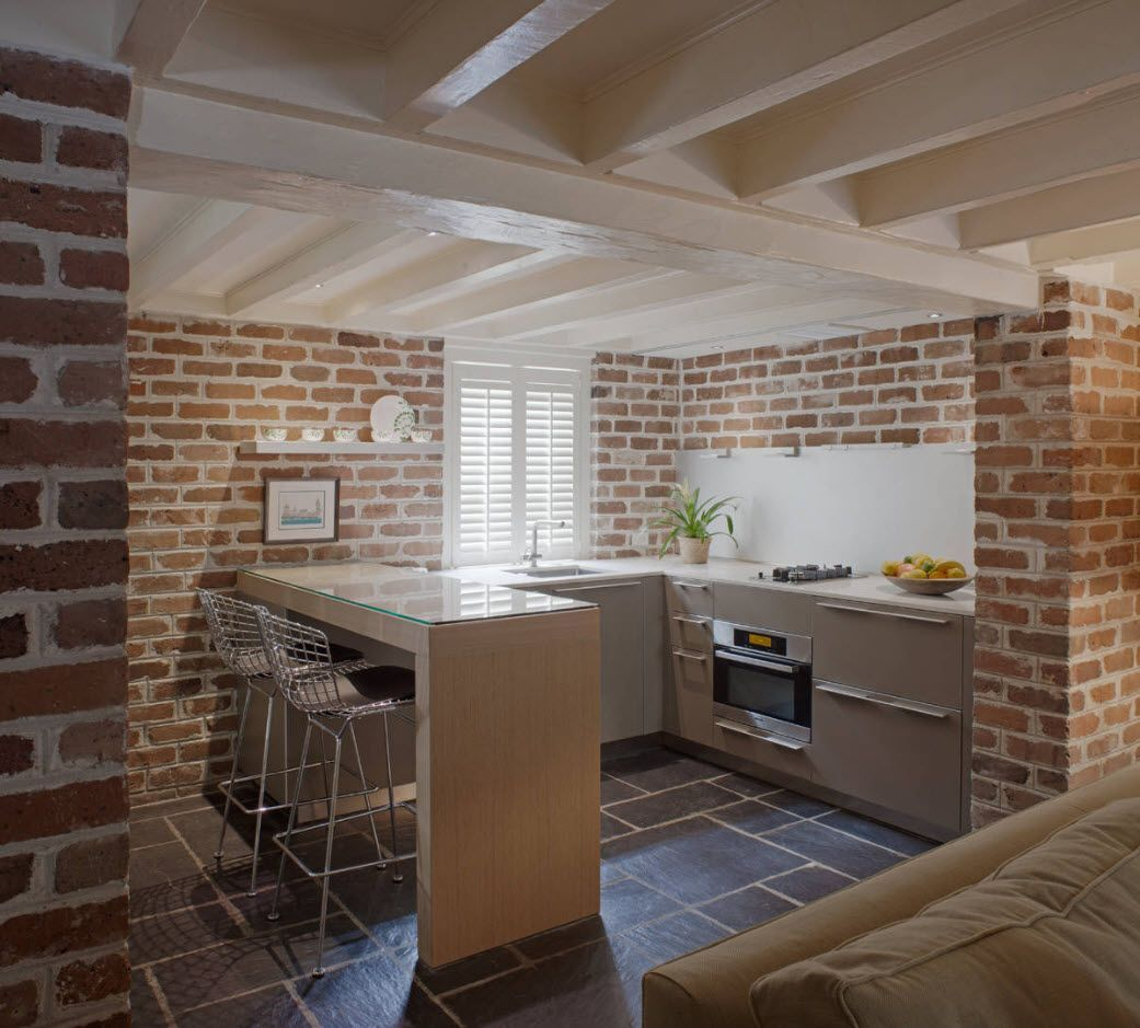 Nice brickwork kitchen interior with log latticed ceiling