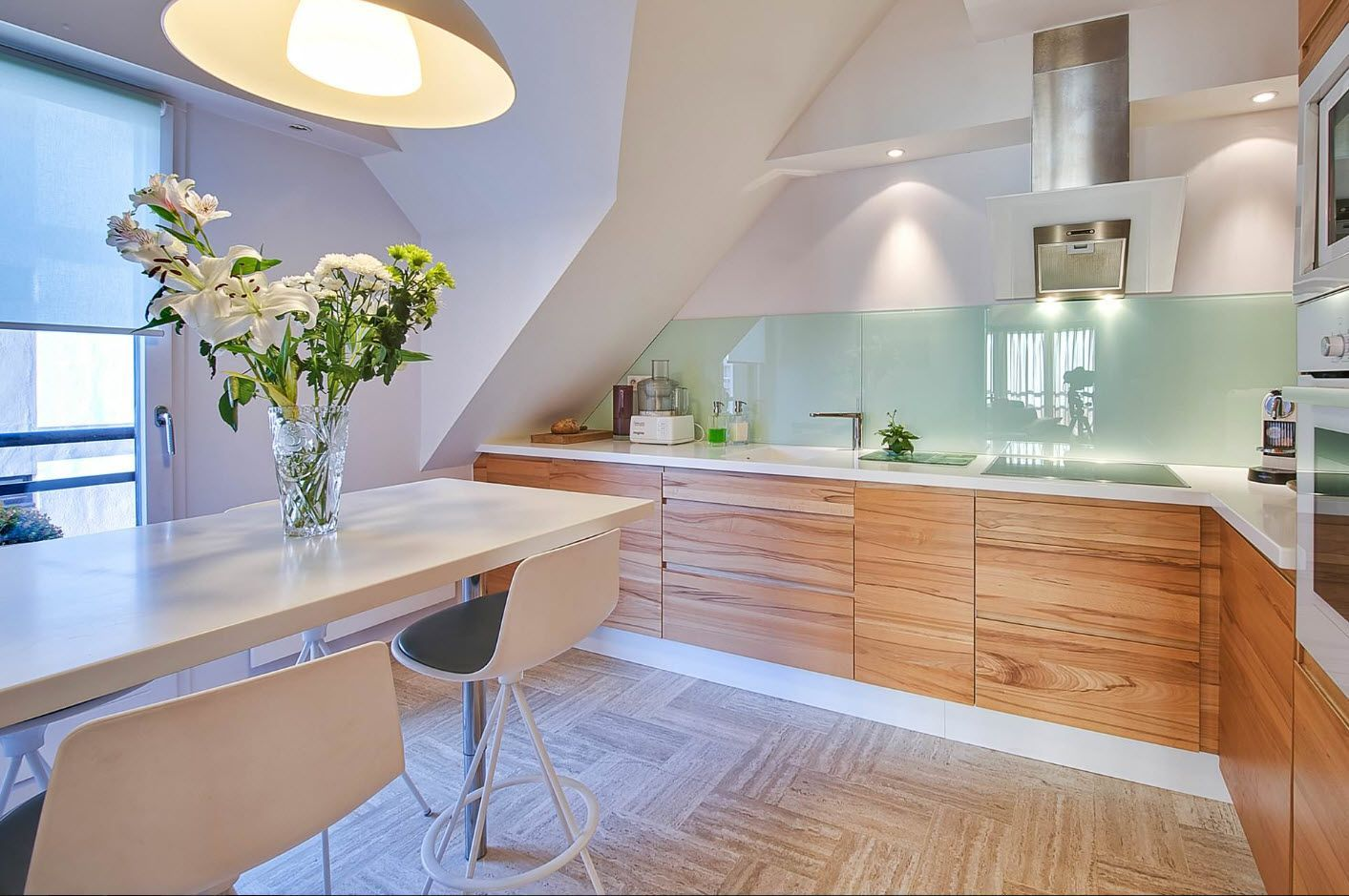 Nice angular design of the kitchen in the light tones