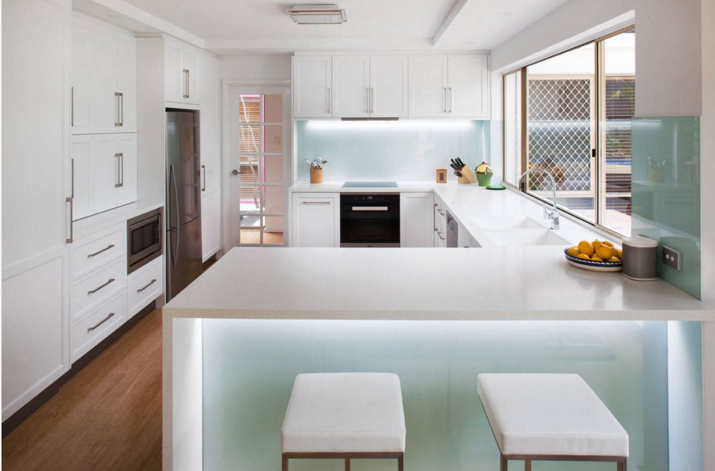 Kitchen's spectacular design with led backlight of the ultramodern island with plastic surface