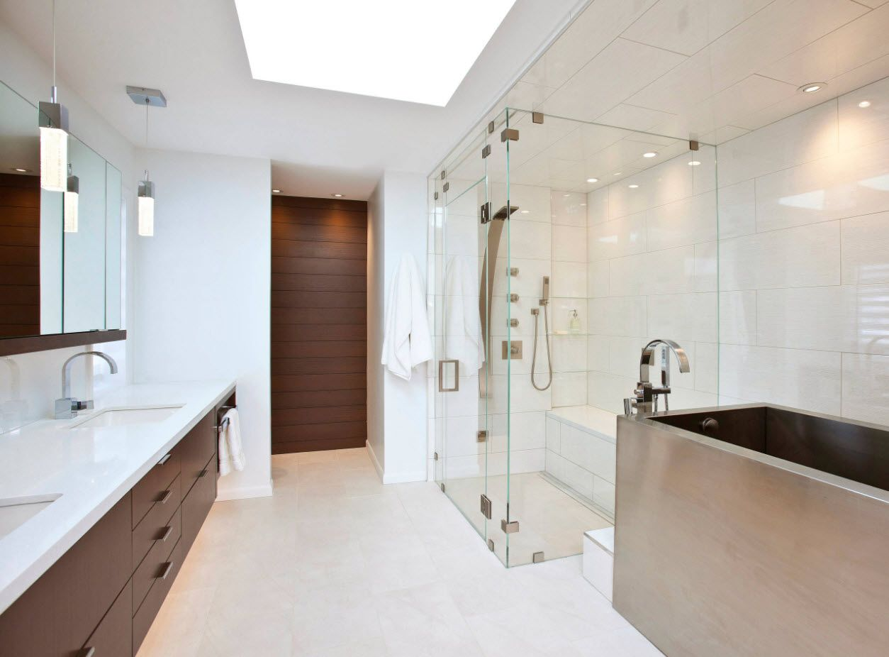 Glass shower cabin in the frame of modern fresh and composed bathroom interior