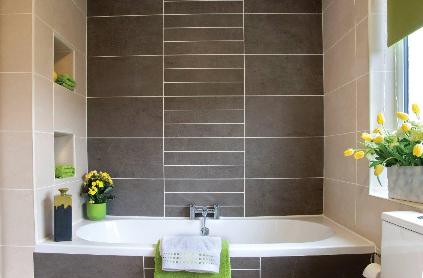 Dark marble surface in the ultramodern bathroom 2017with built up white acrylic bathtub