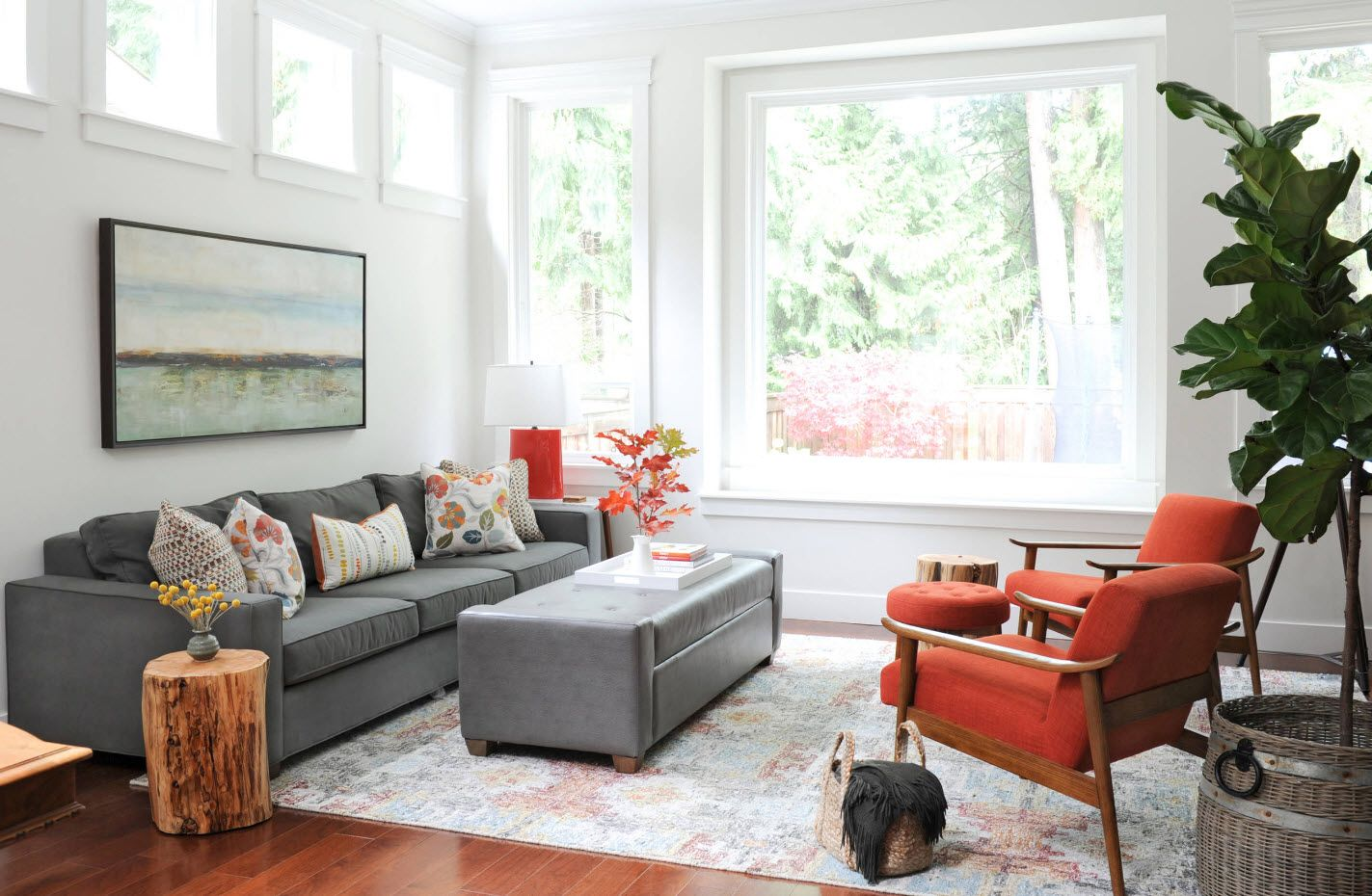gray furniture set and light room trimming with large window