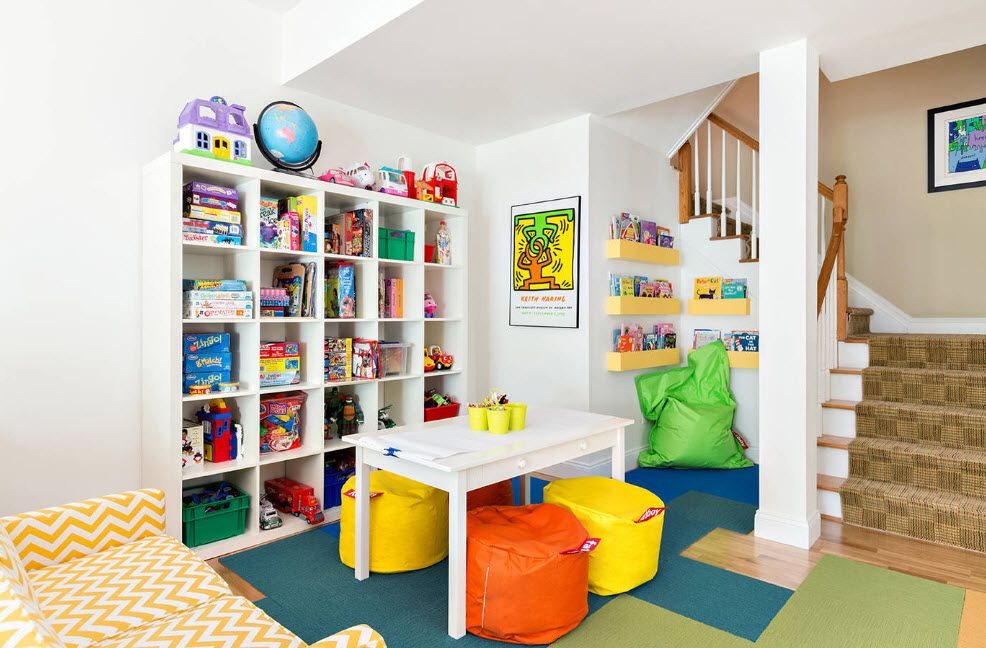 Room relaxing and sports room with colorful chairs and wall shelving