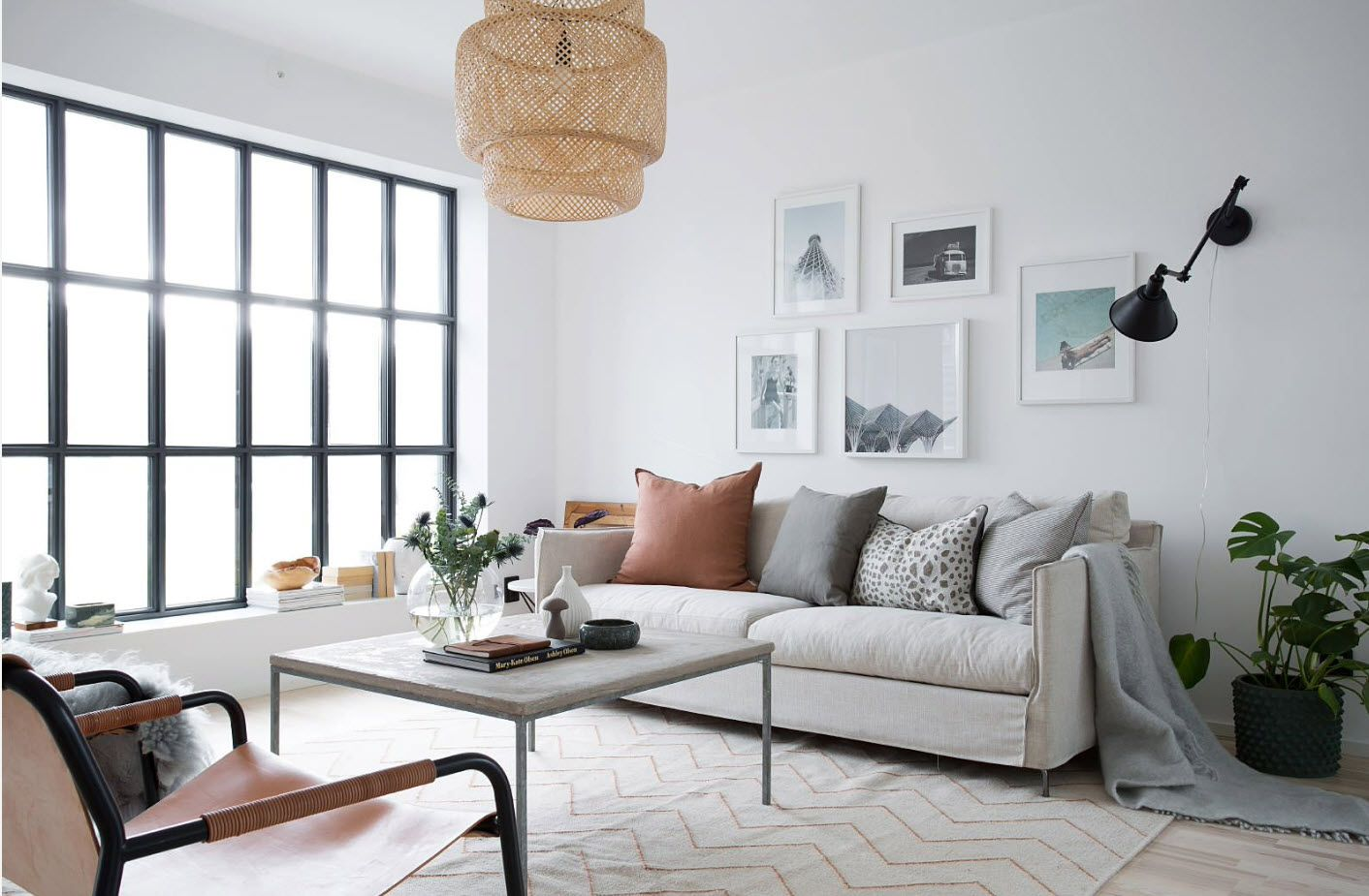 Modern white colored room with pictures as a decoration