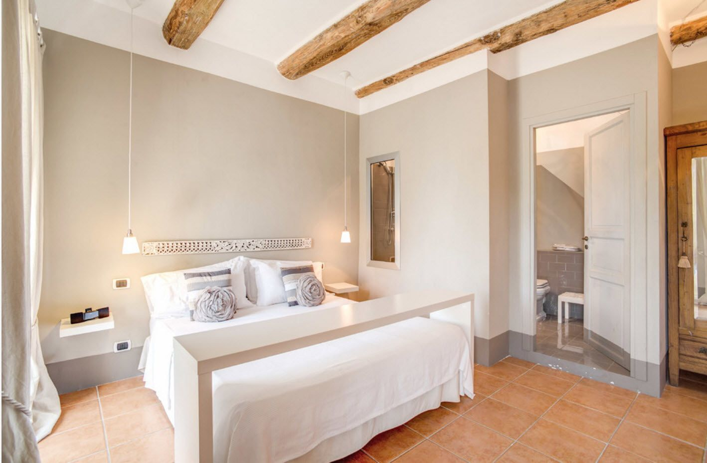 Ceiling beams of large logs in the modern Scandinavian style bedroom image