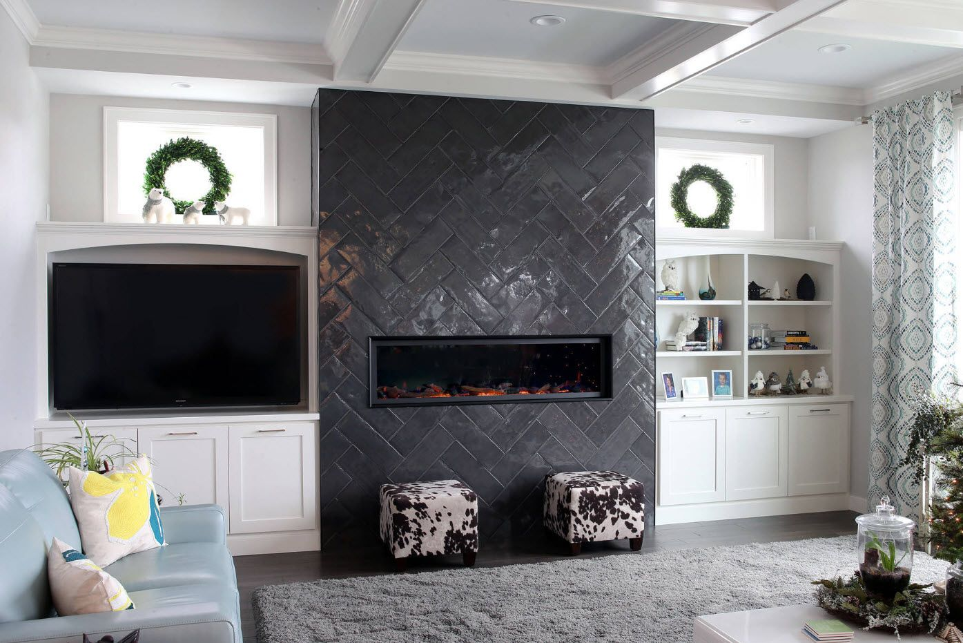 Artificial fireplace built-in to the dark panel at the accent wall
