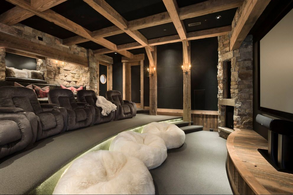 Black ceiling and wall decoration theme in the home theater with bean bags in the first row