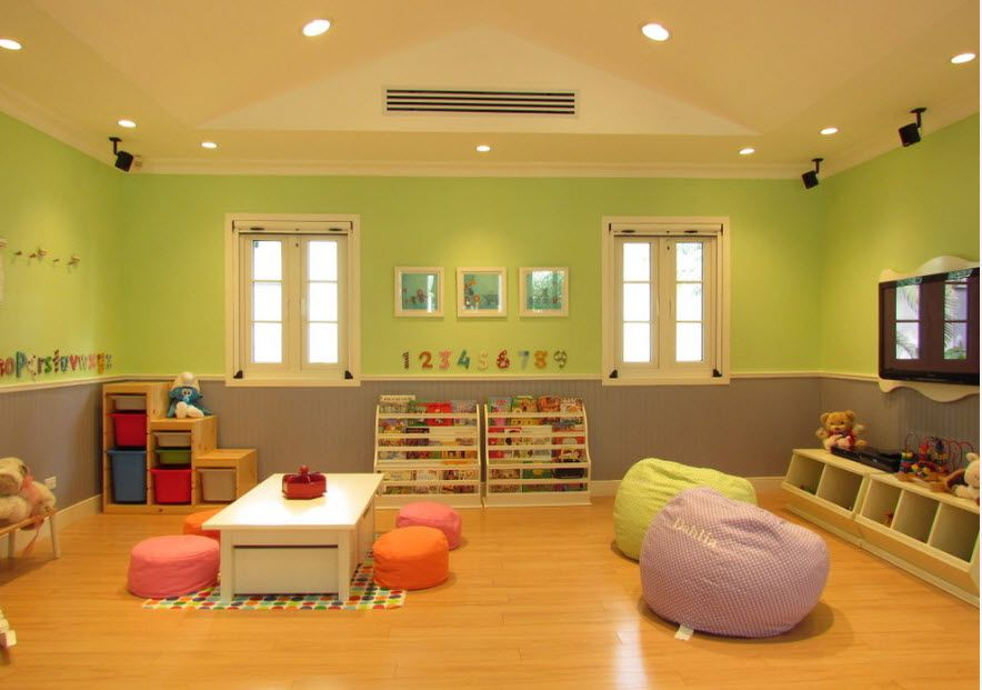 Large children's room with nice wall decoration and slanting ceiling