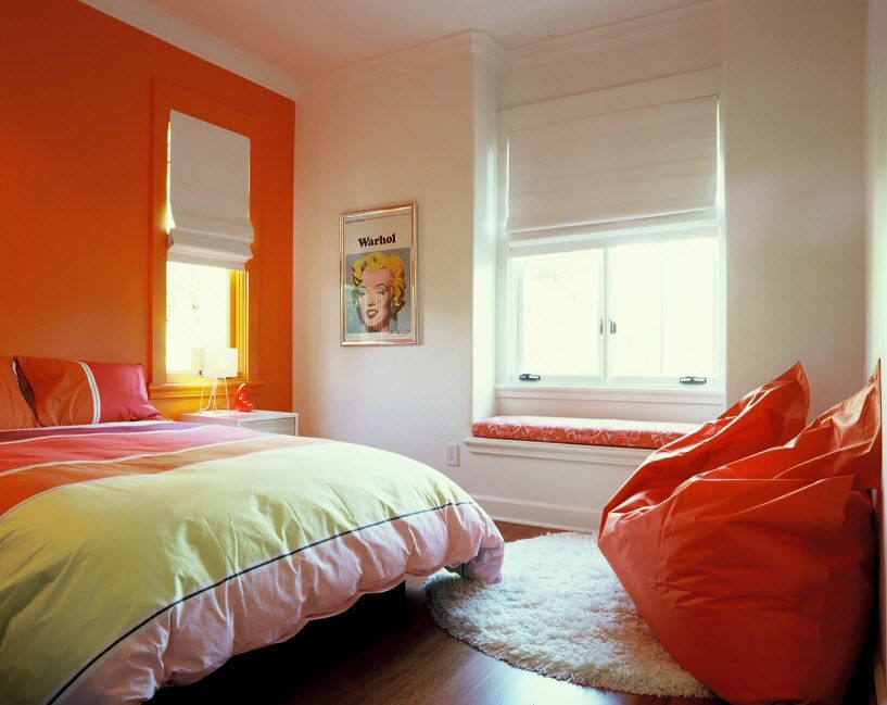 Private and clean kids' room with orange accentual wall