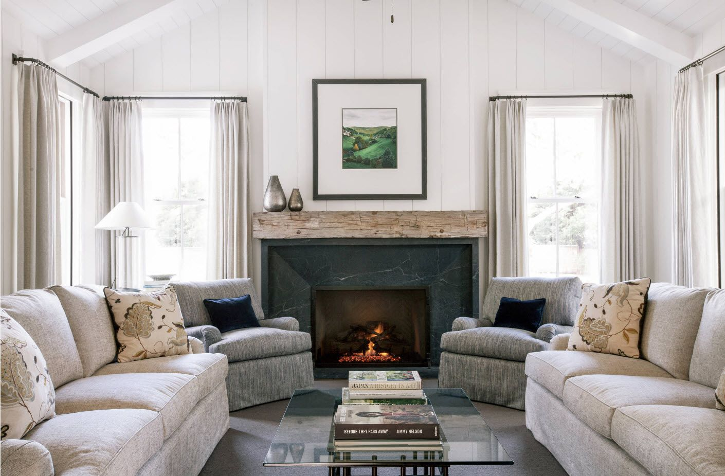 Classic setting in the room with white decoration and fireplace