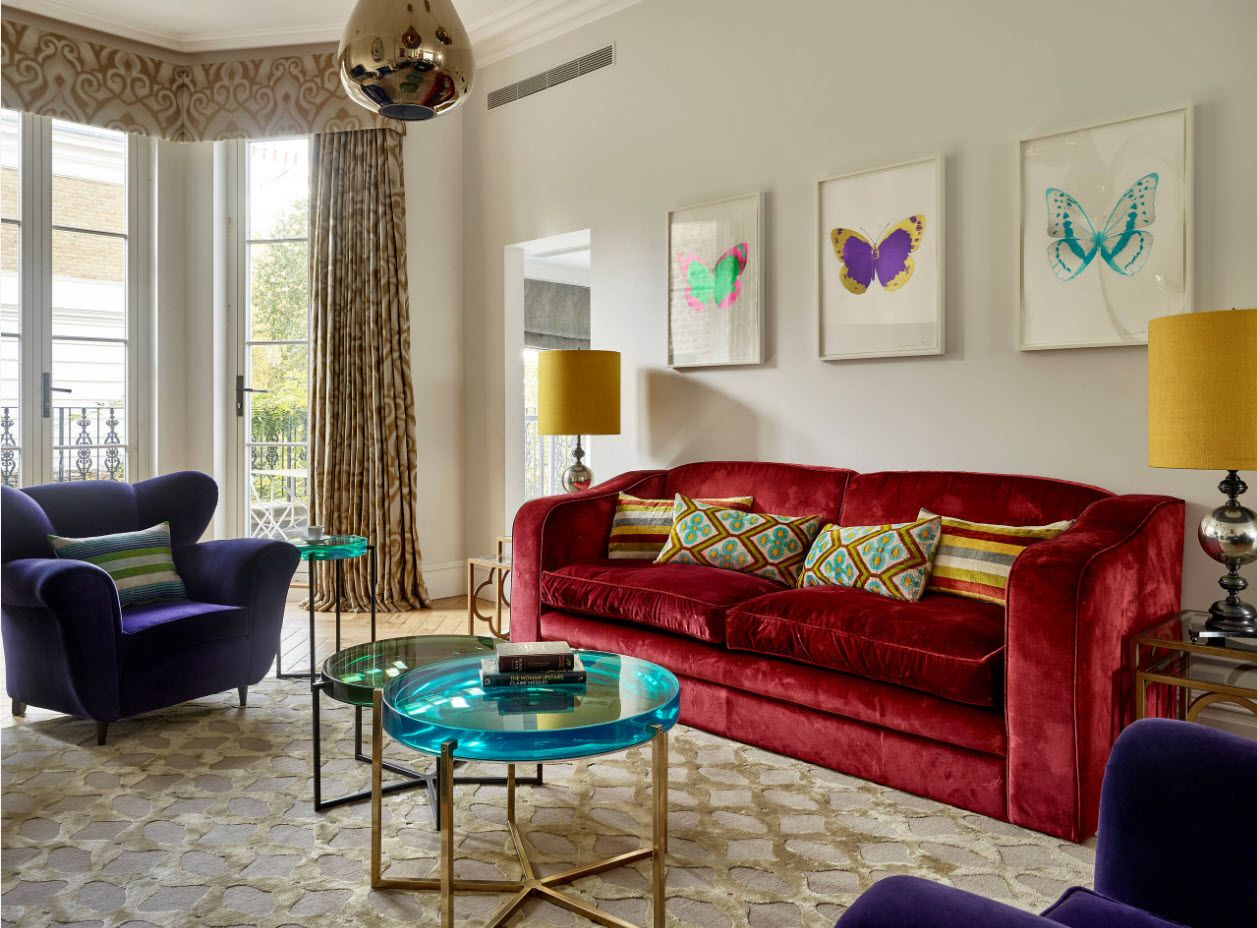 Retro interior with pop-art pretentiousness and red sofa alongwith bunch of pictures