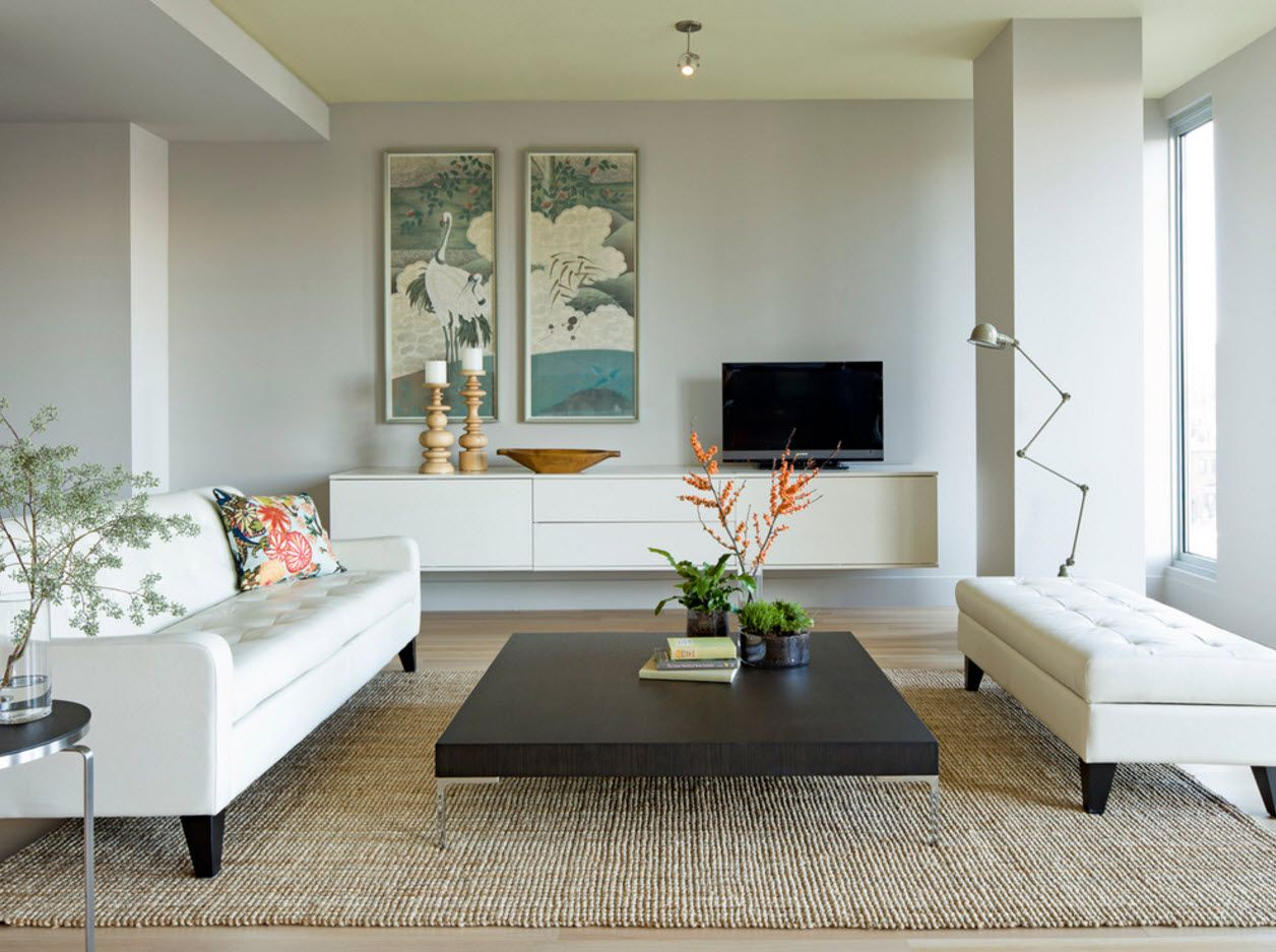 White modern design and as if levitating coffee table with thick wooden counter for the living