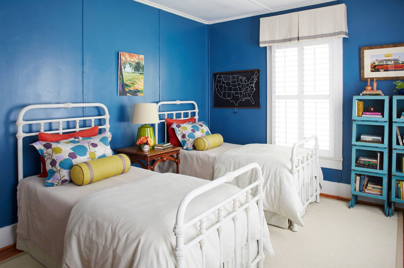 male kids' room with deep blue paint and classic setting