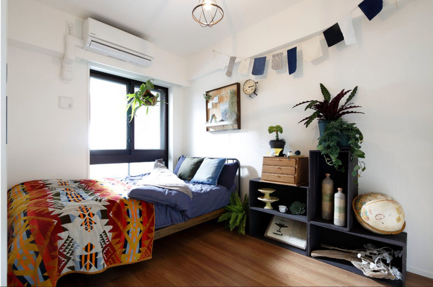 Fresh Marine and eco style mixing in the modern small bedroom with bed near the large window