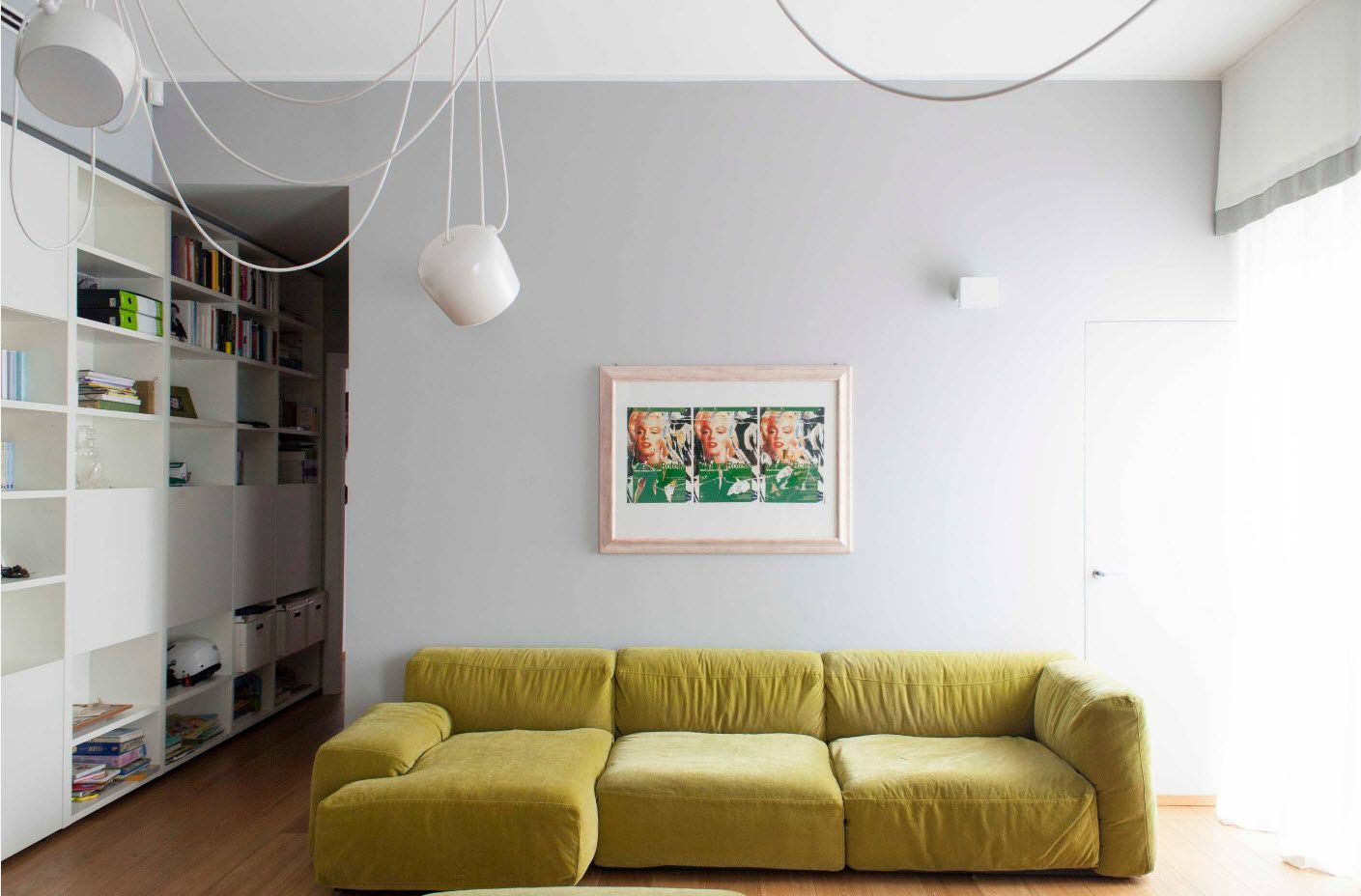 Suspended lamp with open cord and yellow retro sofa in the loft interior
