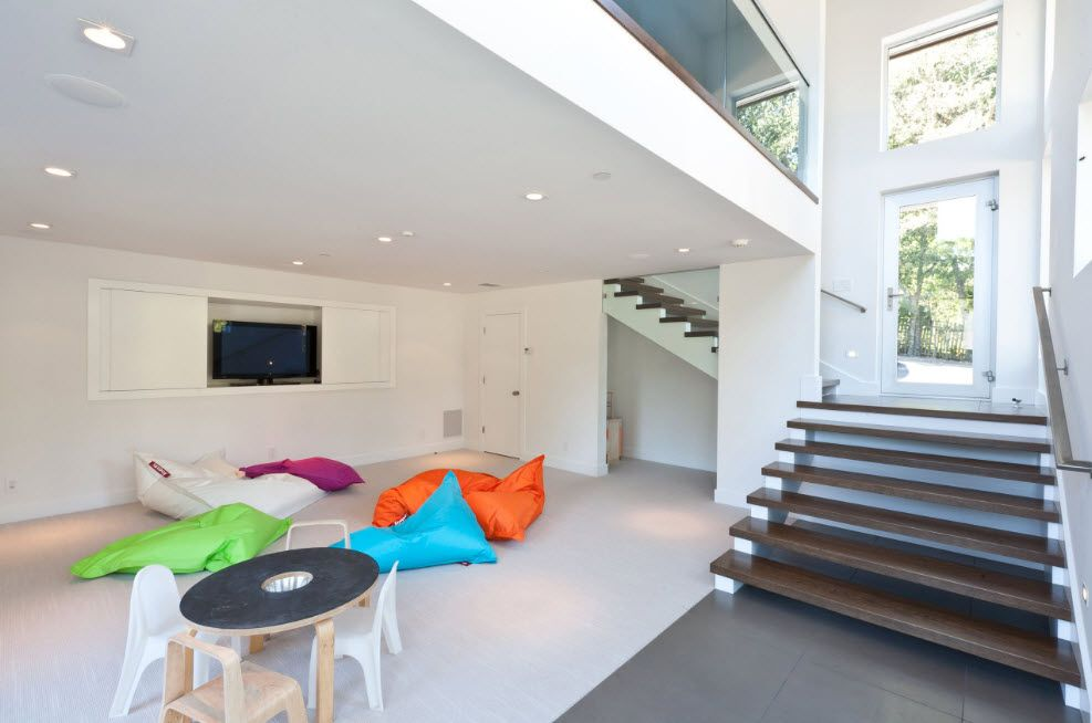 Coloful bean bag seats scattered all round the roomy living space