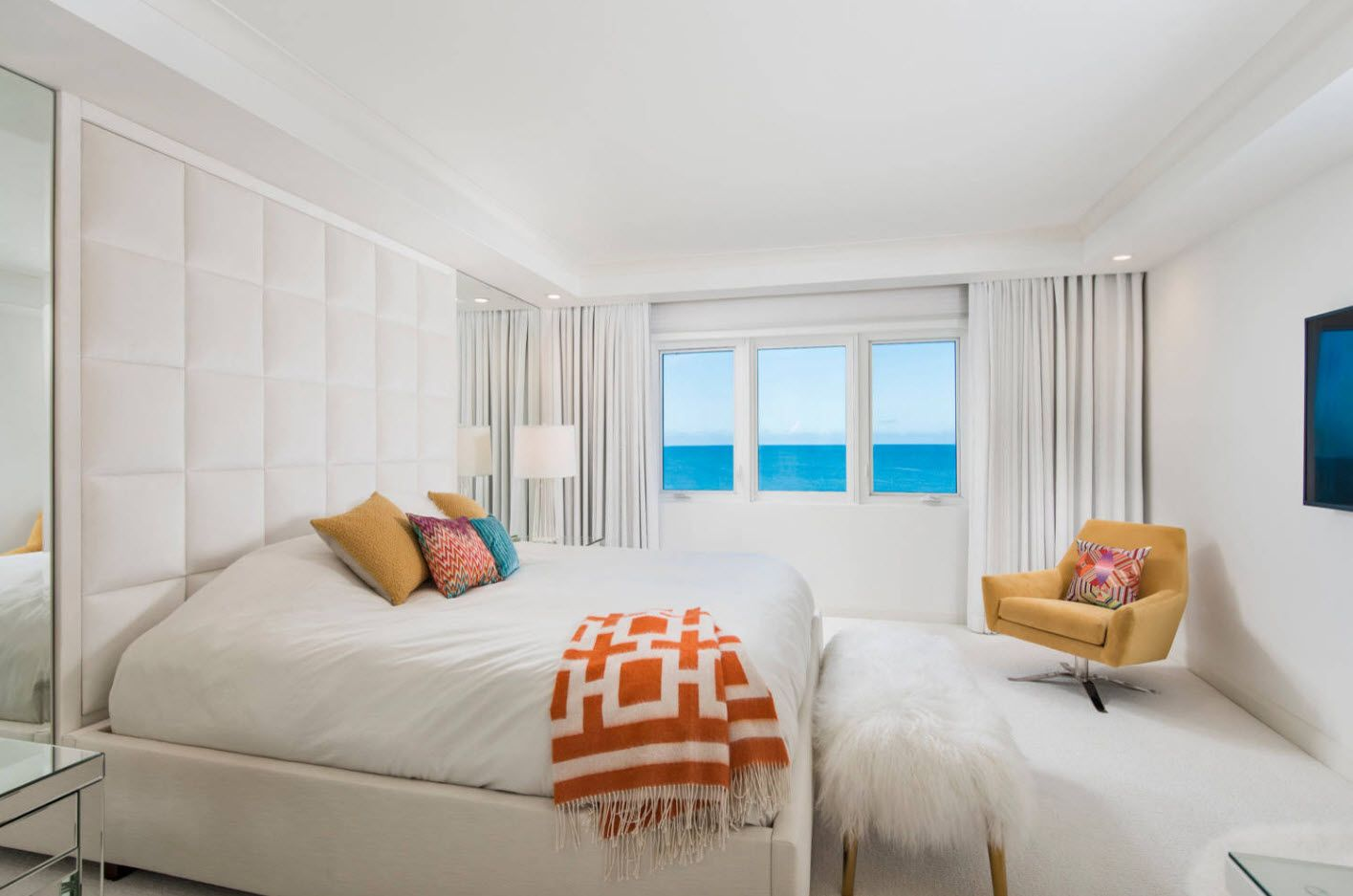 White calming interior of the bedroom near the ocean