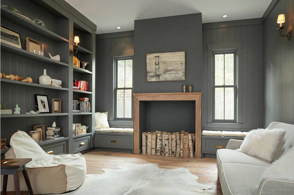 Dark gray with bluish hint wall decoration in the neat English styled interior of the living