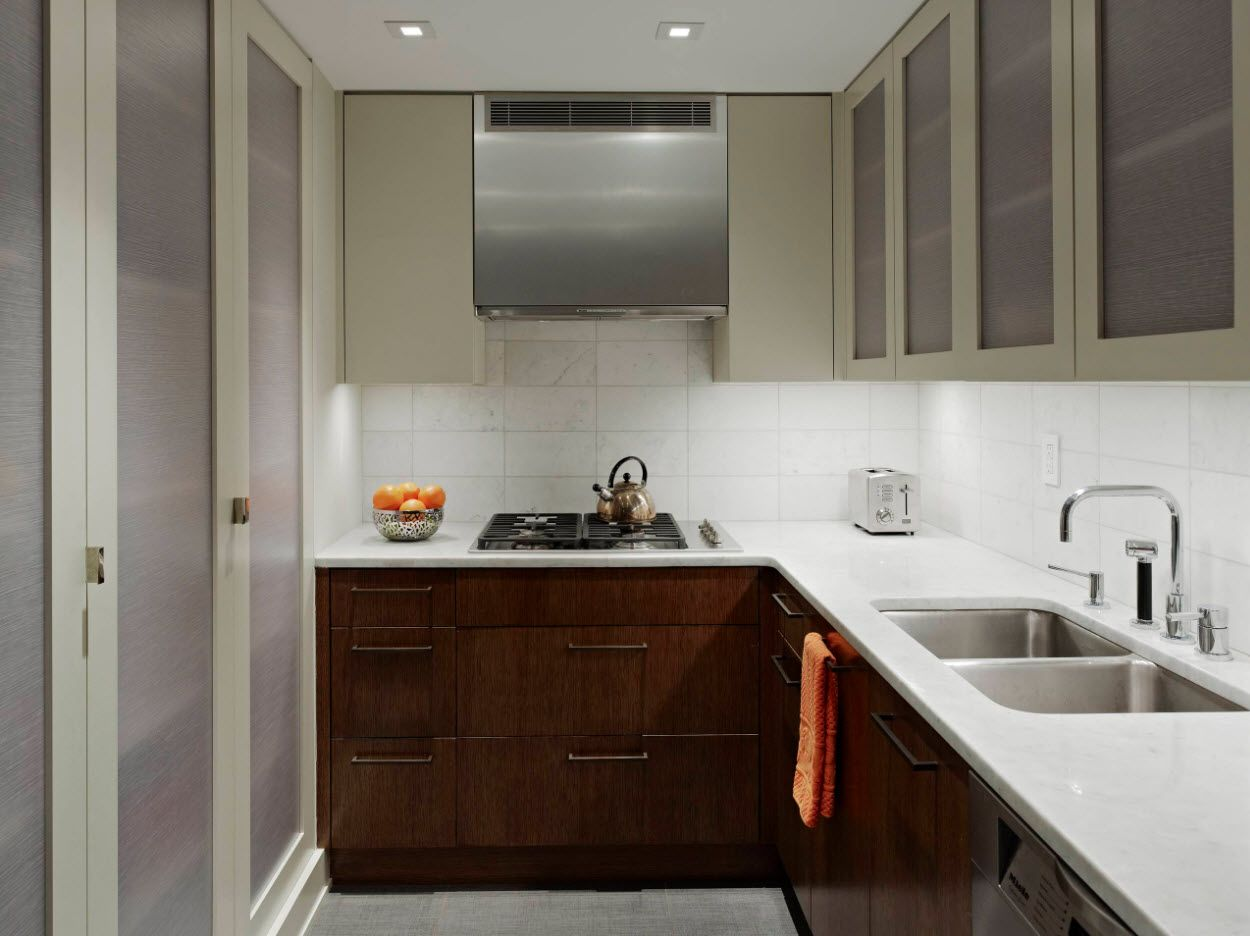 Dark noble wooden bottom and white glance top of the modern kitchen
