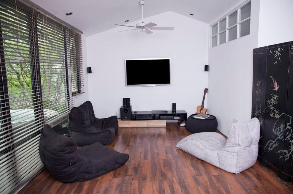 Bean Bag Chair Into the Interiors and Landscape Design of Modern Home with wooden planked floor and black seats