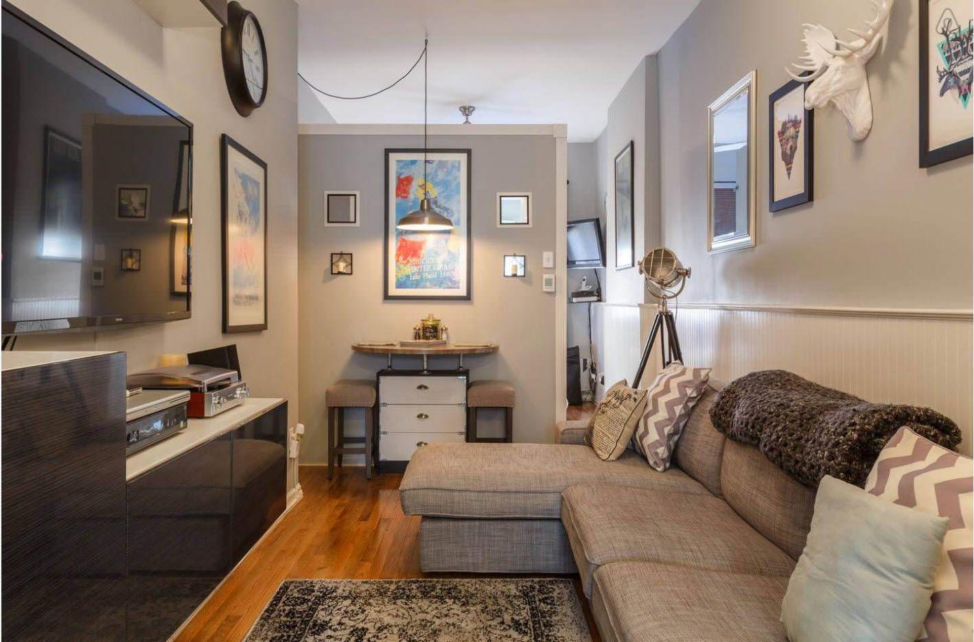 Gray room with angular uphosltered sofa