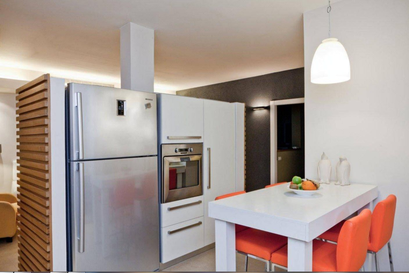 Apartment Interior Design Inspiration Ideas & Trends 2017. Steel surfaces of fridge and oven at the ultramodern kitchen