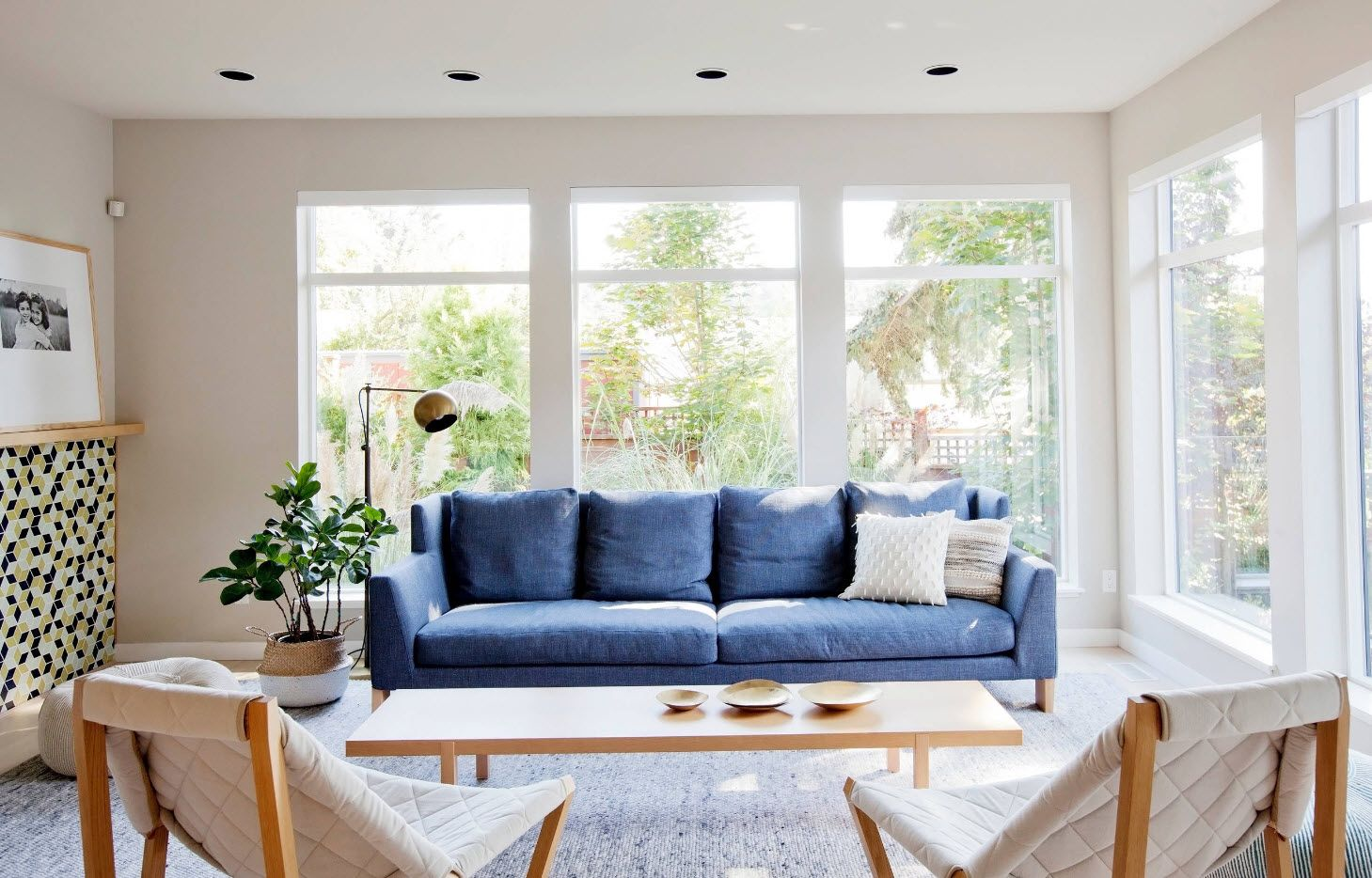 Bright blue sofa accent in the light room