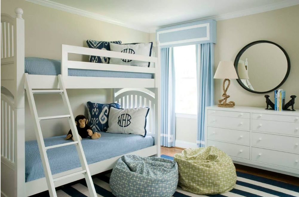 Nice Marine style accord in the little children's room with bunk bed and bean bag chairs