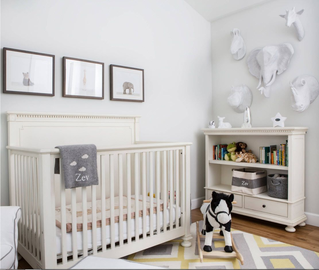 Nice latticed crib fit into the interior if classic decorated children's room