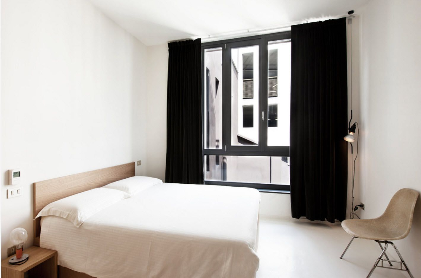 Black drapes look chic in the ascetic white interior