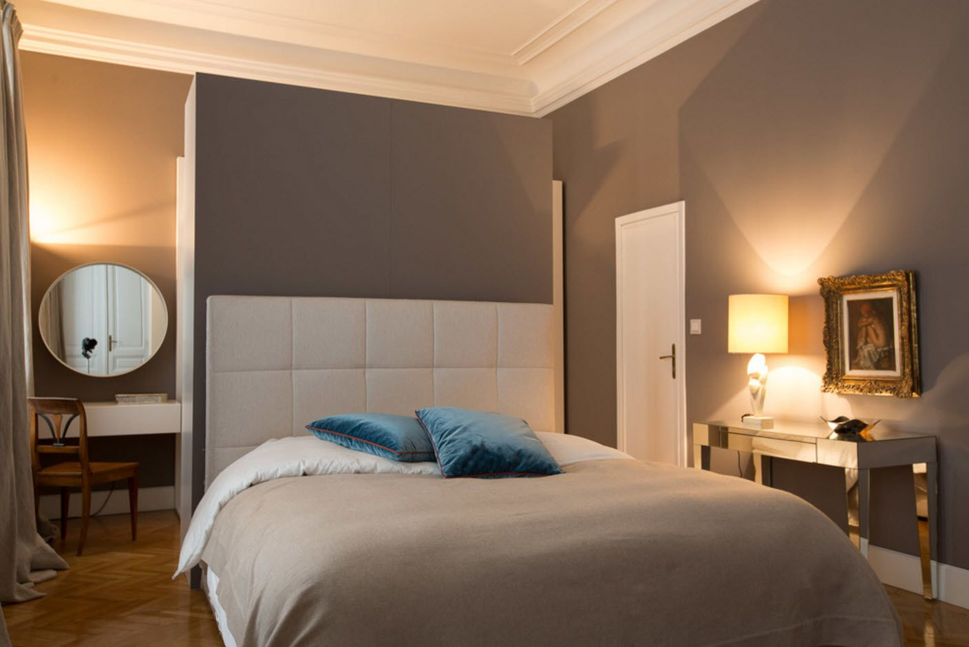 Gray wall decoration and soft square quilted headboard