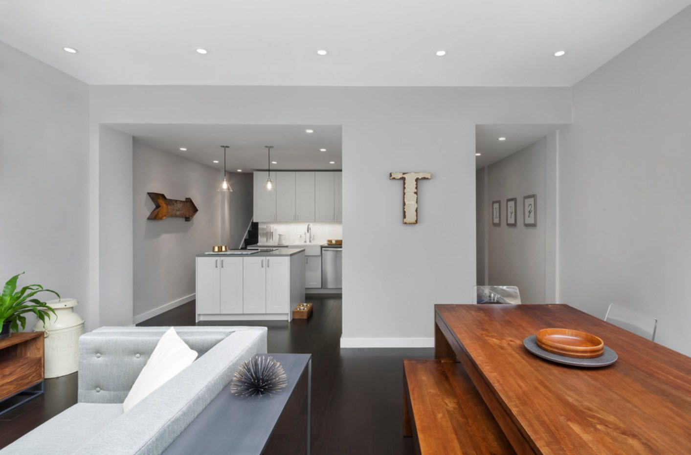 Wooden table and bench in the hi-tech white kitchen zone