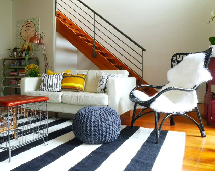 Nice woven bean-bag of round shape on the striped rug