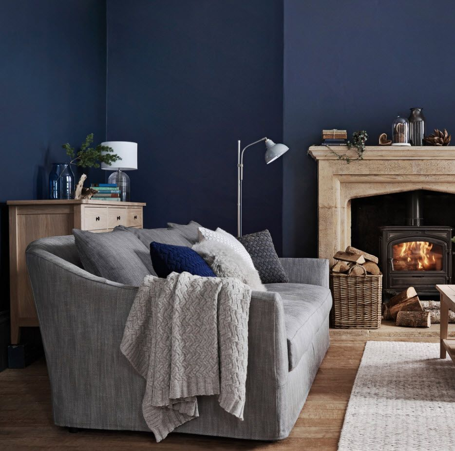 Dark blue wall paint and the fireplace in sitting room 2017