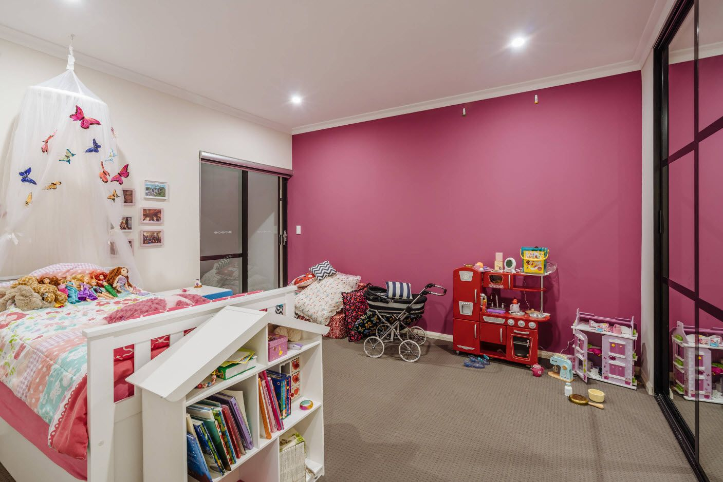 Accent raspberry colored wall in the kids' room