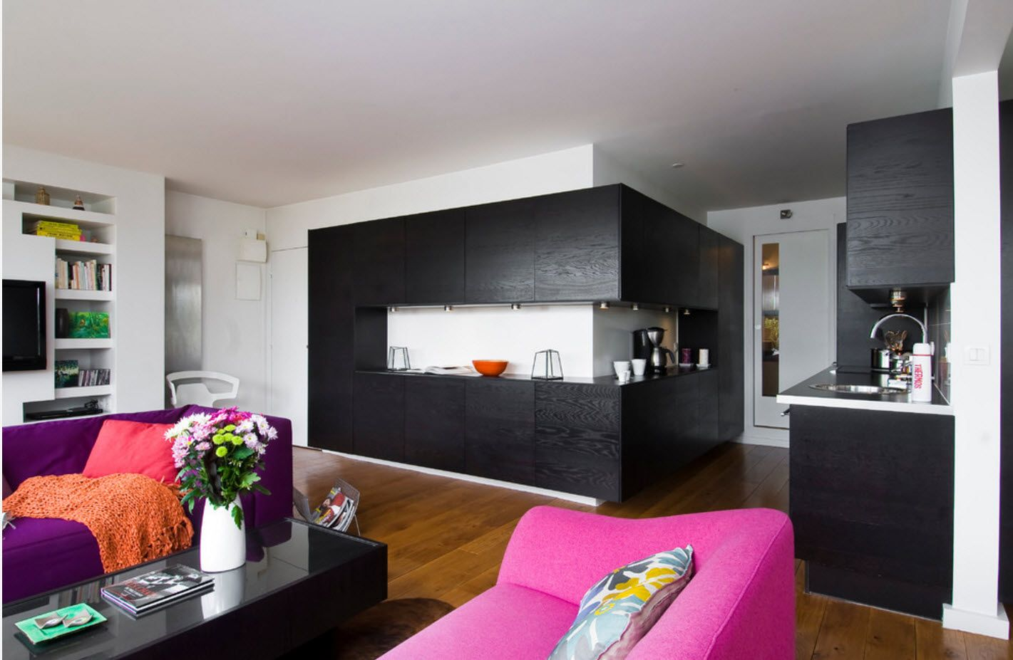 Gorgeous modern angular black monolith of kitchen set