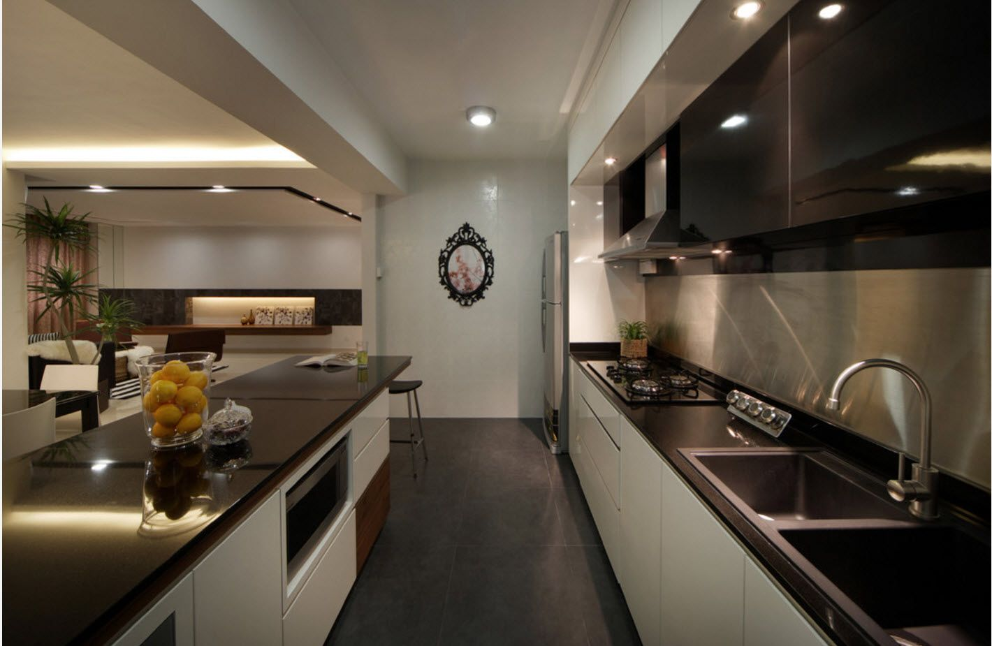 Galley kitchen in hi-tech style with noble dark wooden countertops