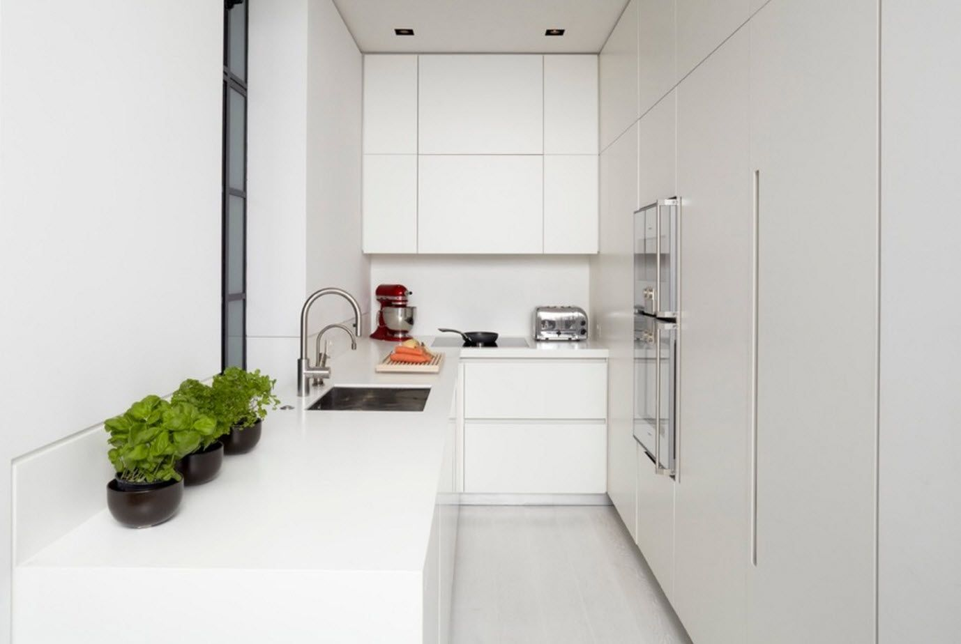 White plastic facades of the kitchen